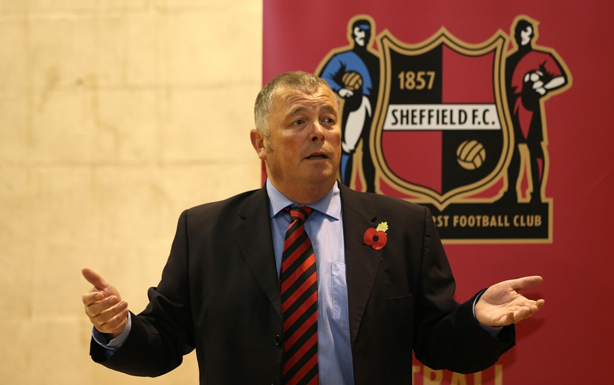 Photo of Richard Tims with Sheffield FC logo in background