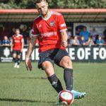 Male Sheffield FC player kicking ball